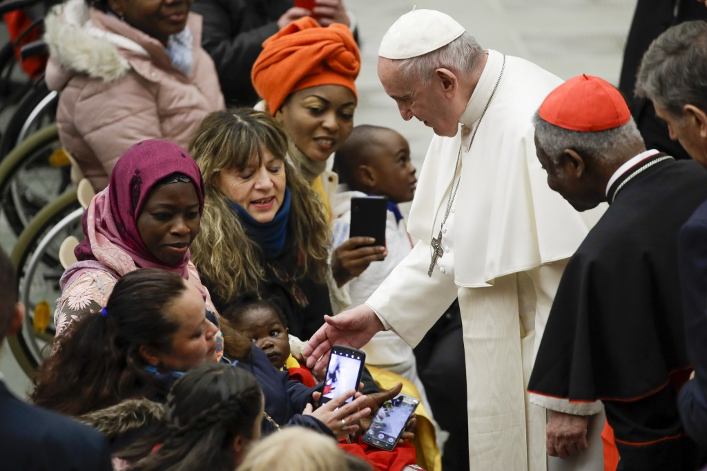 Pope Francis meets people during his weekly general audience, in Paul VI Hall at the Vatican, Wednesday, Jan. 15, 2020. (AP Photo/Alessandra Tarantino...