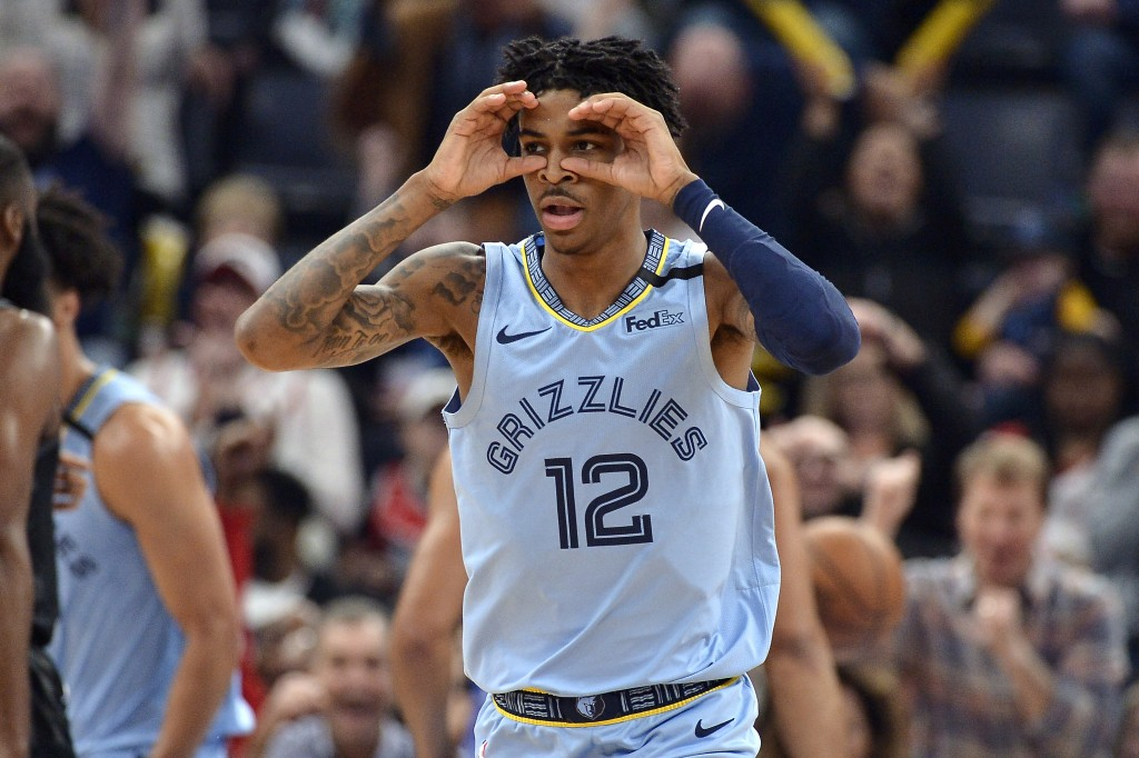 Memphis Grizzlies guard Ja Morant reacts after an assist in the first half of the team's NBA basketball game against the Houston Rockets on Tuesday, J...
