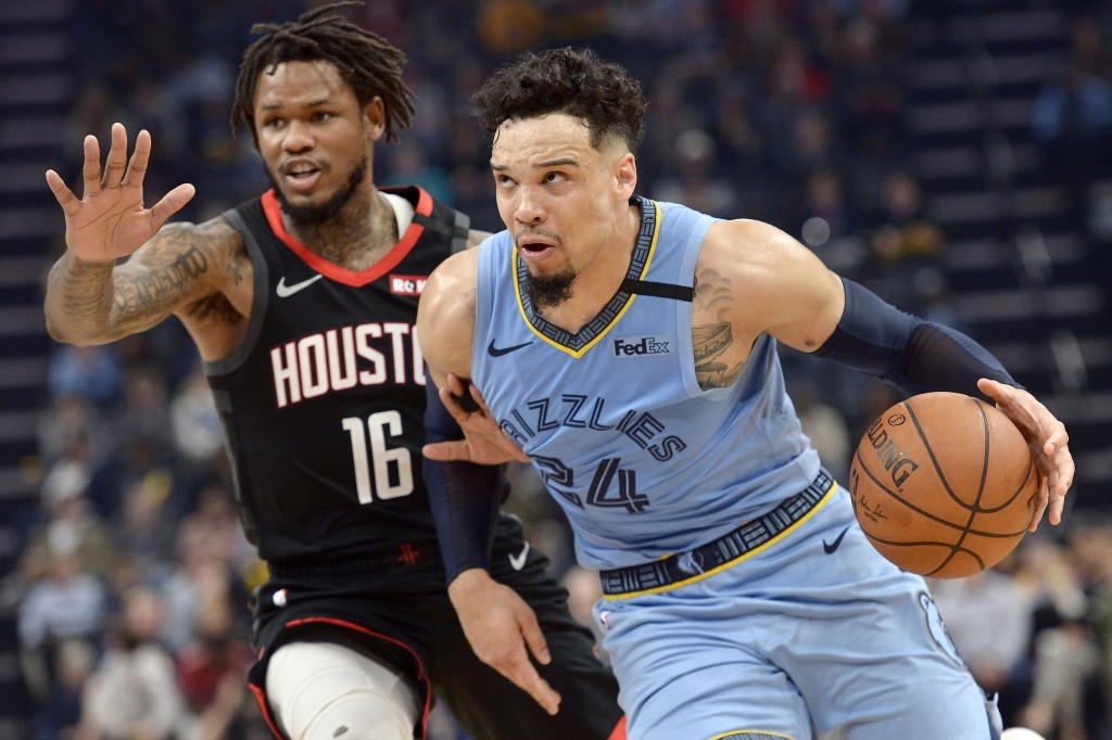 Memphis Grizzlies guard Dillon Brooks (24) drives next to Houston Rockets guard Ben McLemore during the second half of an NBA basketball game Tuesday,...
