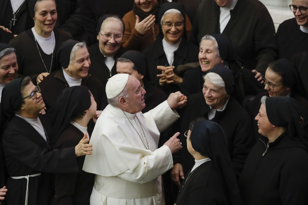 Pope Francis greets a group of nuns during his weekly general audience, in Paul VI Hall at the Vatican, Wednesday, Jan. 15, 2020. (AP Photo/Alessandra...