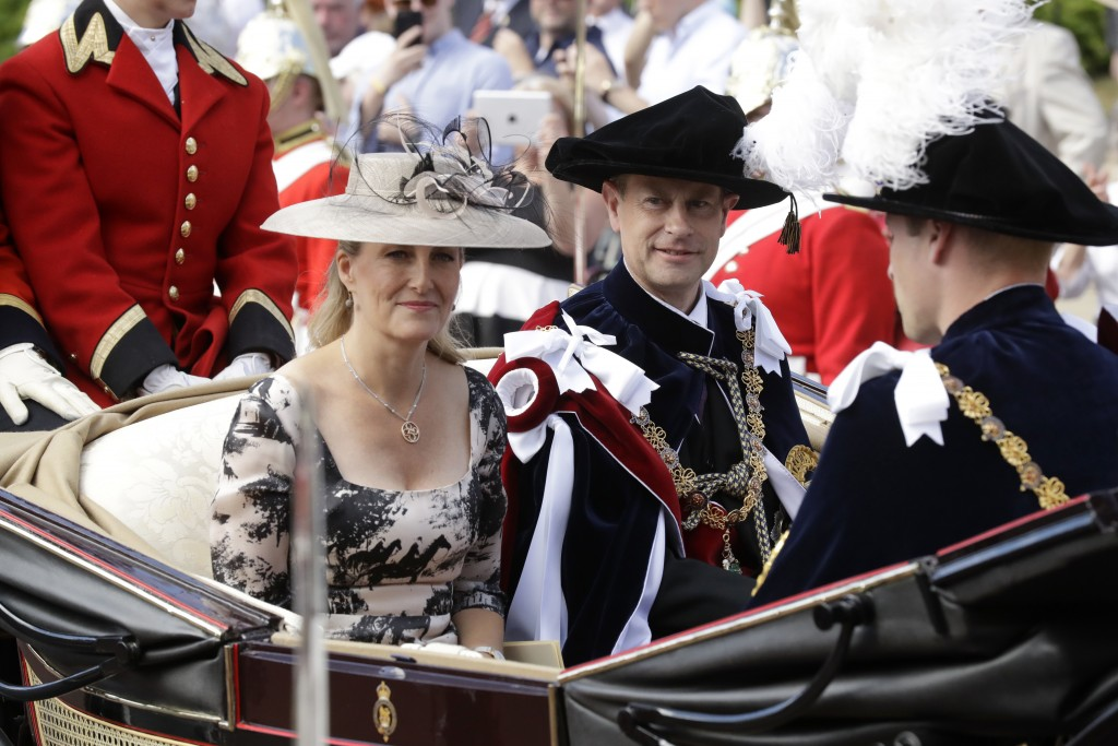 FILE - In this Monday, June 18, 2018 file photo, Britain's Prince Edward, center, in his roles as Knight Companion and his wife Sophie, Countess of We...