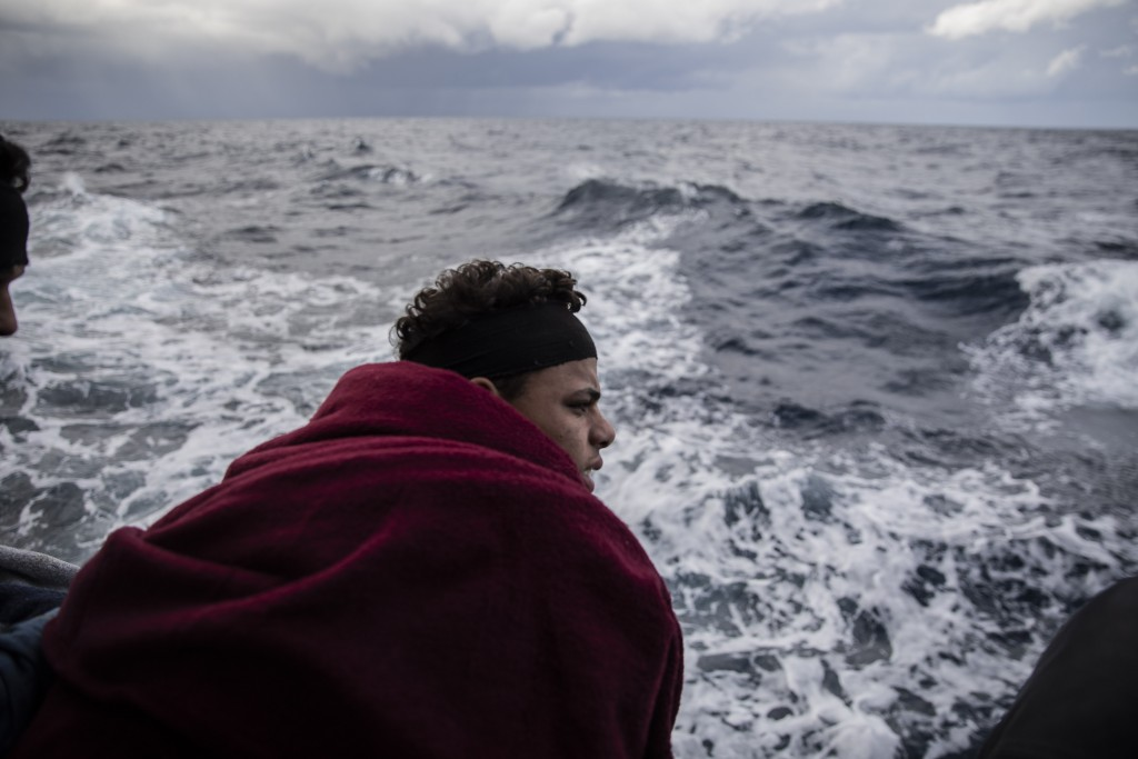 In this Monday Jan. 13, 2020 photo, a Moroccan boy watches the sea on board the Spanish NGO Open Arms vessel, as the NGO waits for the authorities to ...
