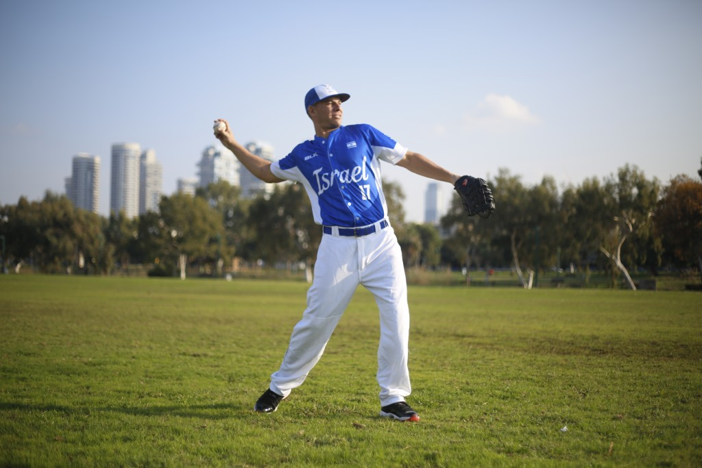 In this Tuesday, Jan. 14, 2020 photo, Danny Valencia throws a ball during Israel's national baseball team practice, in Tel Aviv, Israel. As a baseball...