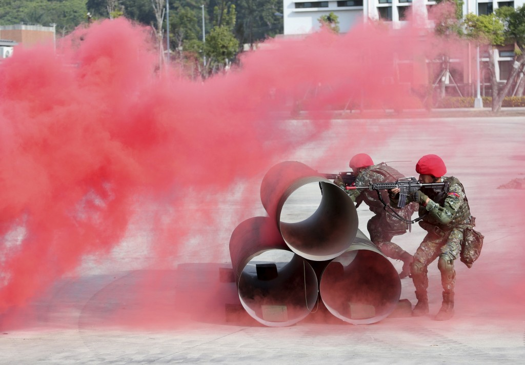 Two soldiers of fictitious enemy fire during a military exercise in Kaohsiung, southern Taiwan, Wednesday, Jan. 15, 2020. Taiwan military started a tw...