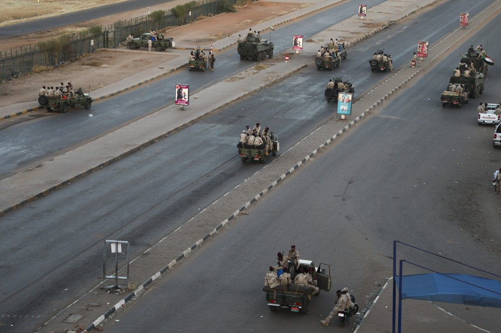Members of the Rapid Support Forces, a paramilitary force operated by the Sudanese government, block roads in Khartoum, Sudan, Tuesday, Jan. 14, 2020....