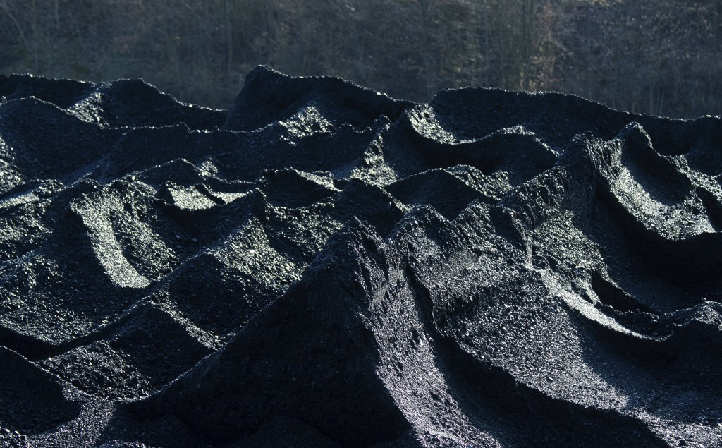 Hard coal is stored in the coal port of the Mehrum coal-fired power plant in the district of Peine in Hohenhameln, Germany, Wednesday, Jan. 15, 2020. ...