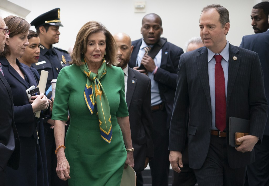 Speaker of the House Nancy Pelosi, D-Calif., joined by House Intelligence Committee Chairman Adam Schiff, D-Calif., leaves a lengthy closed-door meeti...