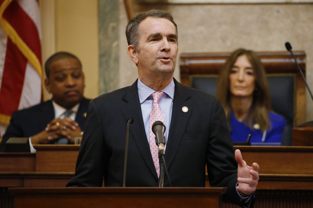 FILE - In this Jan. 8, 2020, file photo, Virginia Gov. Ralph Northam, center, gestures as he delivers his State of the Commonwealth address as House S...