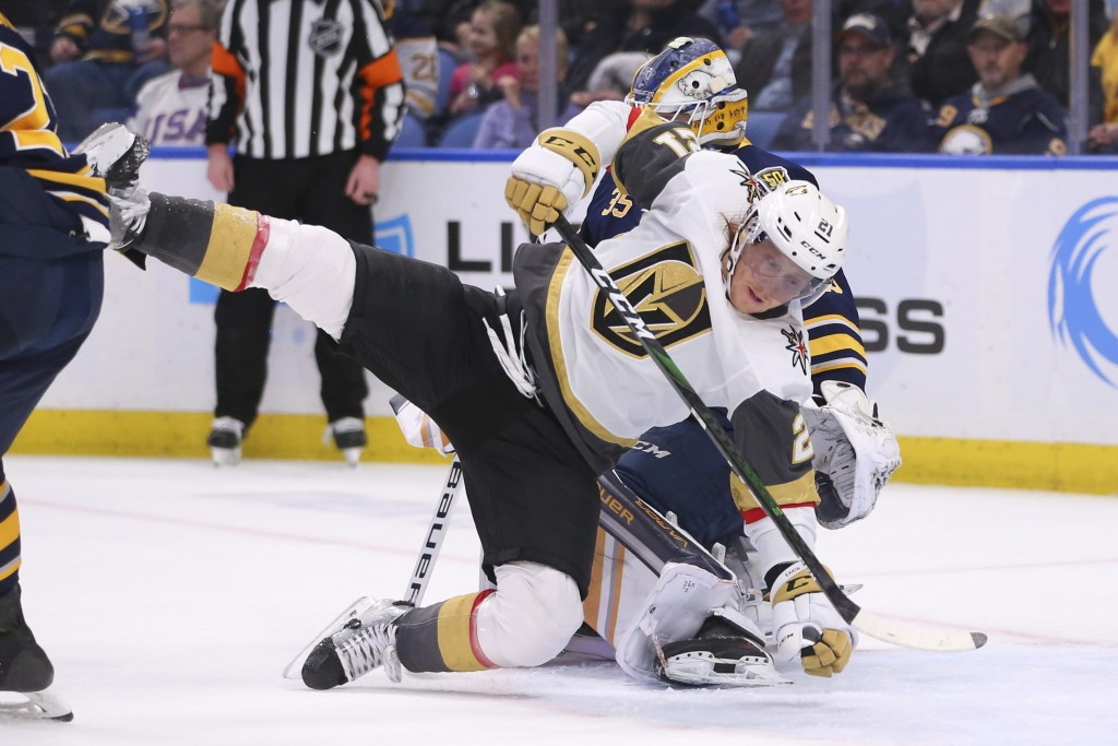 Buffalo Sabres goalie Linus Ullmark (35) brings down Vegas Golden Knights forward Cody Eakin (21) during the second period of an NHL hockey game Tuesd...