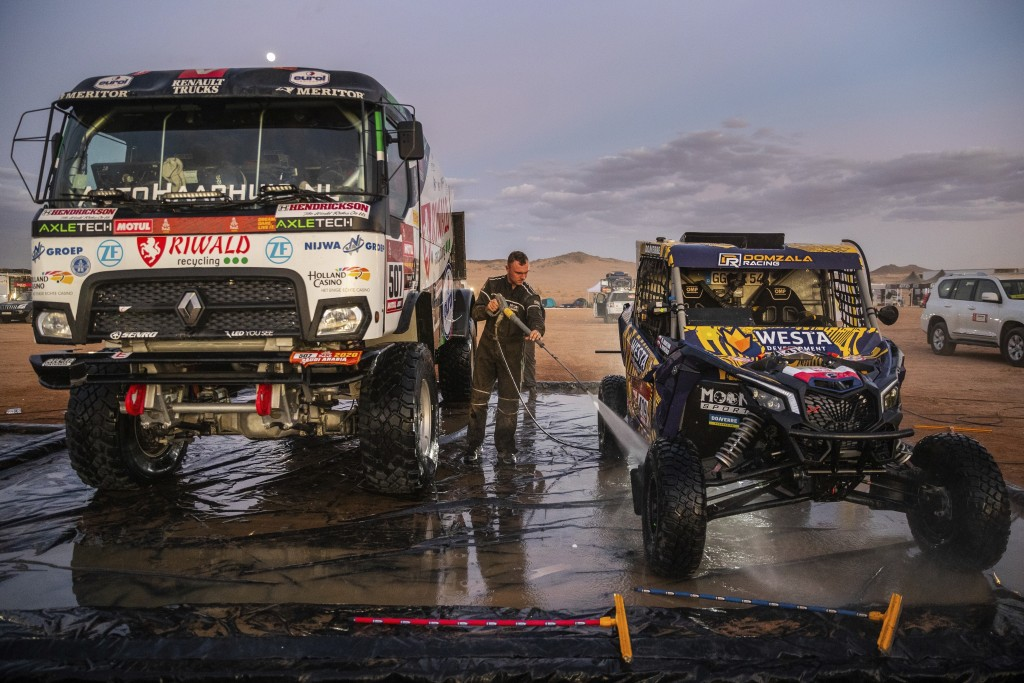 In this Thursday, Jan. 9, 2020 photo, a competitor washes a Can-Am SSV after stage five of the Dakar Rally in Hail, Saudi Arabia. Formerly known as th...