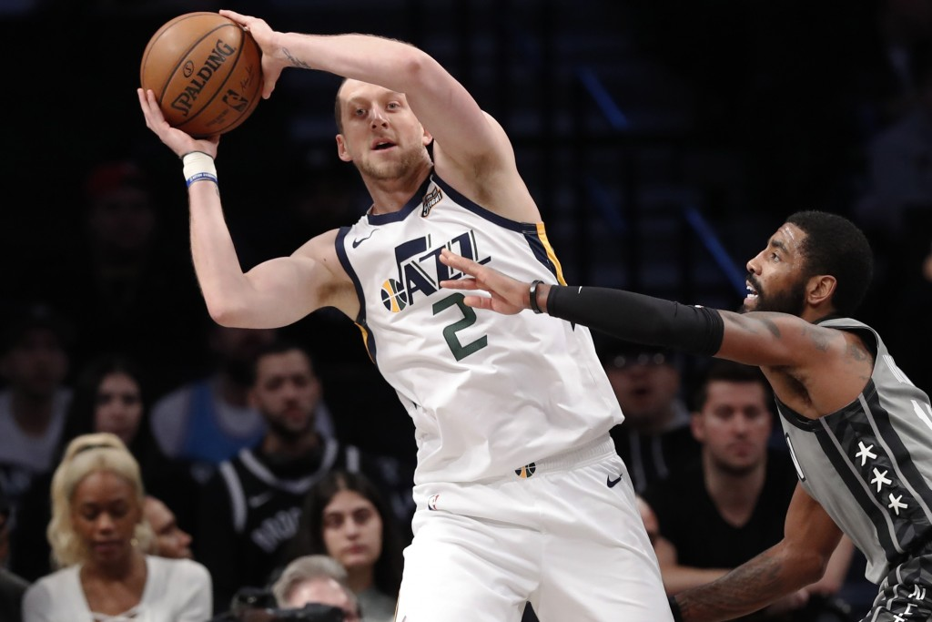 Utah Jazz forward Joe Ingles (2) looks to pass the ball as Brooklyn Nets guard Kyrie Irving, right, defends during the first quarter of an NBA basketb...