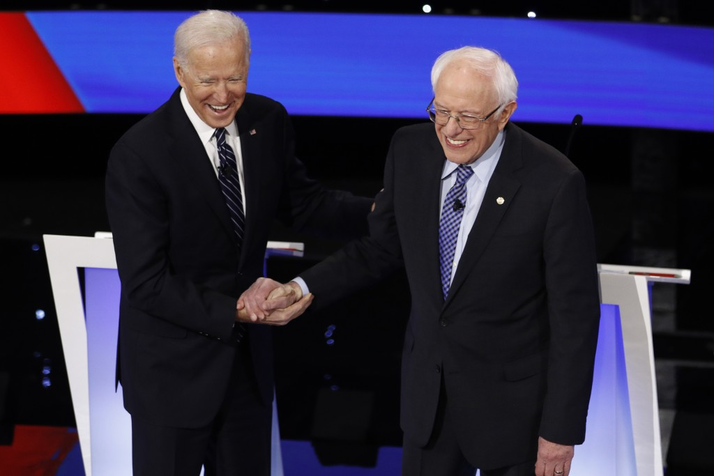 Democratic presidential candidates former Vice President Joe Biden, left, and Sen. Bernie Sanders, I-Vt., greet each other Tuesday, Jan. 14, 2020, bef...