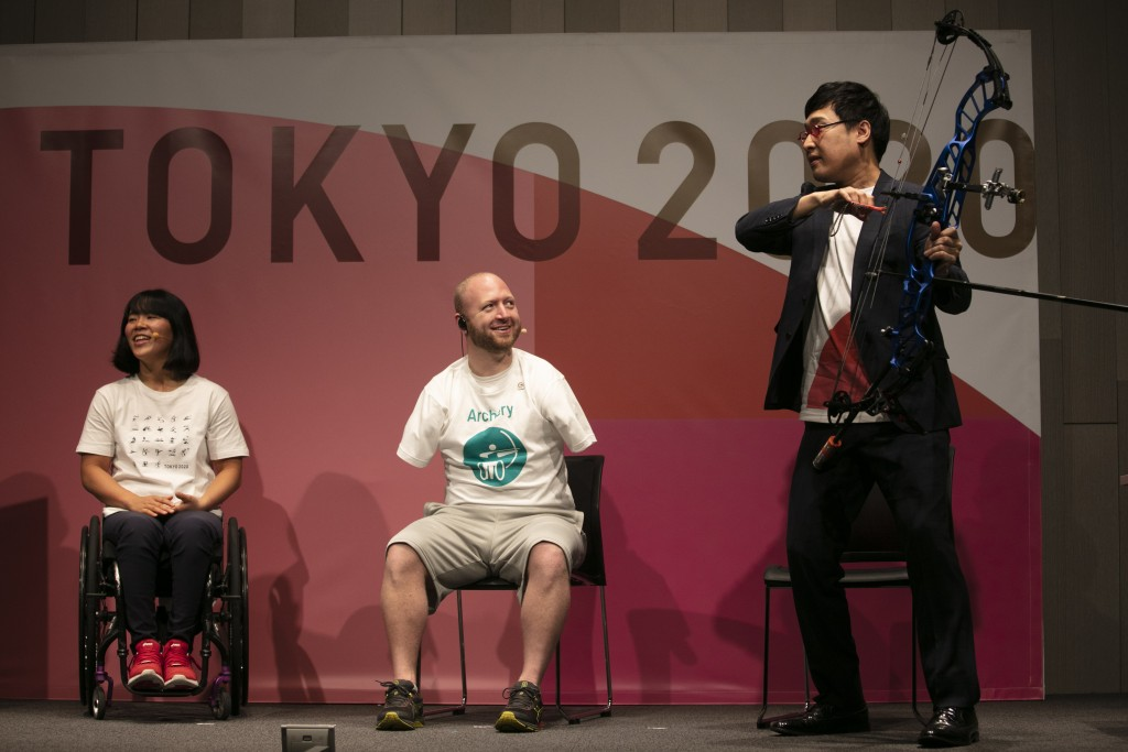 Joined by Paralympian Monika Seryu, left, and comedian Ryota Yamasato, armless archer Matt Stutzman attends an event held to unveil tickets for the To...