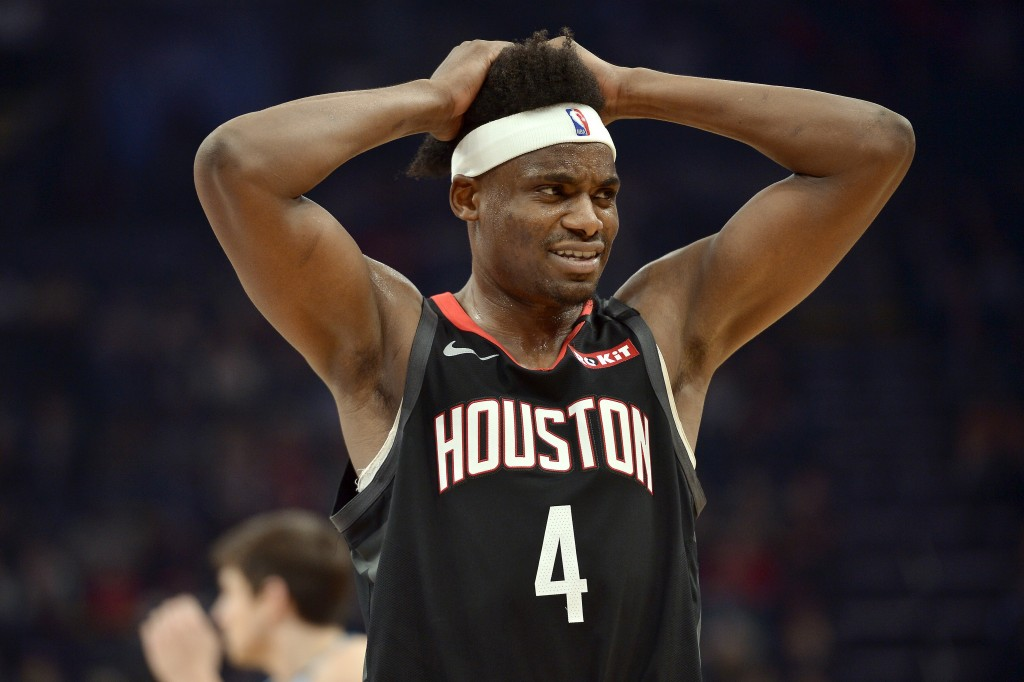 Houston Rockets forward Danuel House Jr. (4) reacts during the second half of the team's NBA basketball game against the Memphis Grizzlies on Tuesday,...