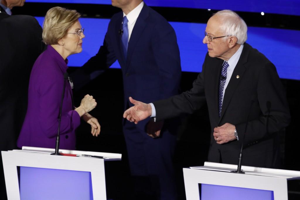 Democratic presidential candidate Sen. Elizabeth Warren, D-Mass., left and Sen. Bernie Sanders, I-Vt. talk Tuesday, Jan. 14, 2020, after a Democratic ...