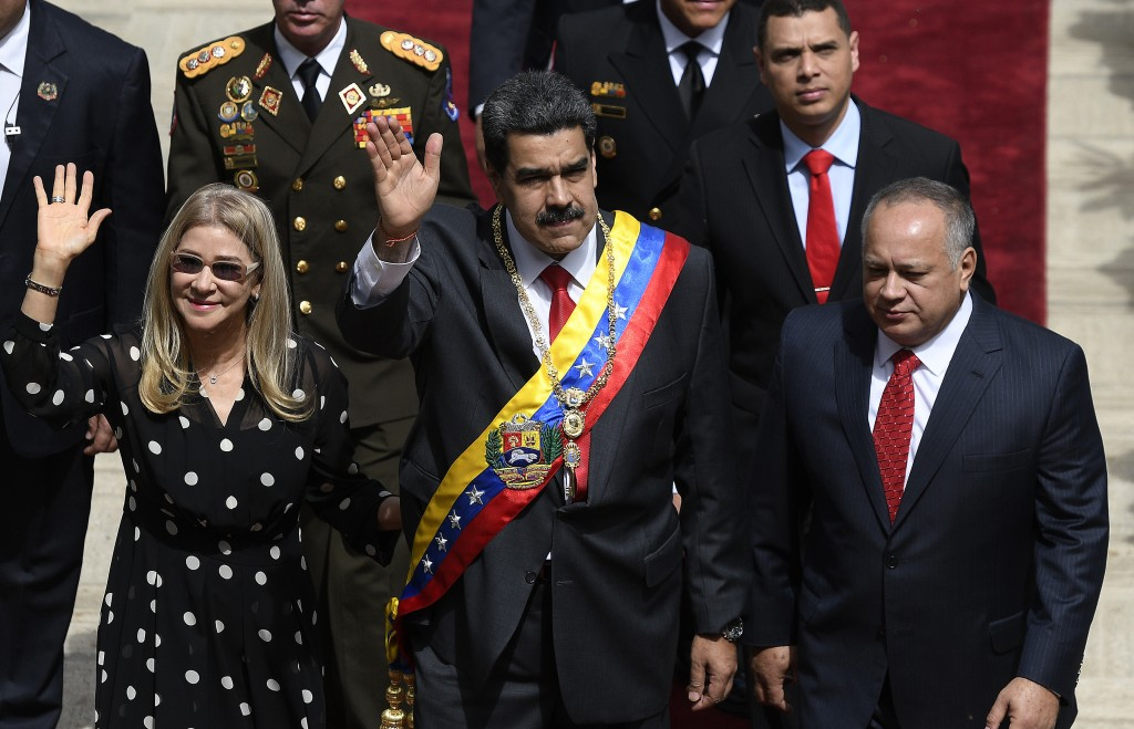 Venezuela's President Nicolas Maduro, center, first lady Cilia Flores, left, and Constituent Assembly President Diosdado Cabello arrive to the grounds...