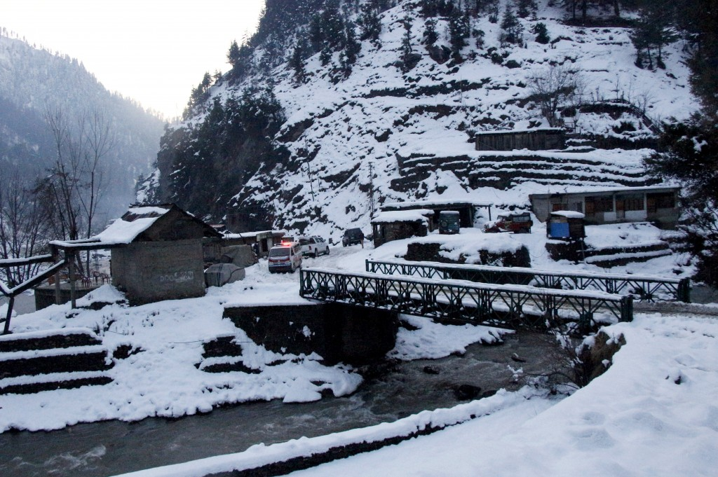 An ambulance heading to an area hit by avalanches, waits for a blocked road to be opened, in Keran, a small town in Neelum Valley, Pakistan-administer...