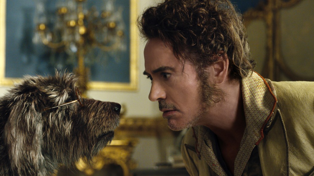 This image released by Universal Pictures shows Dr. John Dolittle, portrayed by Robert Downey Jr., right, with Jip, voiced by Tom Holland, in a scene ...