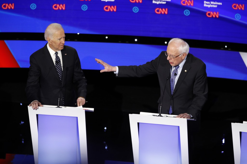 Democratic presidential candidate former Vice President Joe Biden, left, watches as Sen. Bernie Sanders, I-Vt., answers a question Tuesday, Jan. 14, 2...