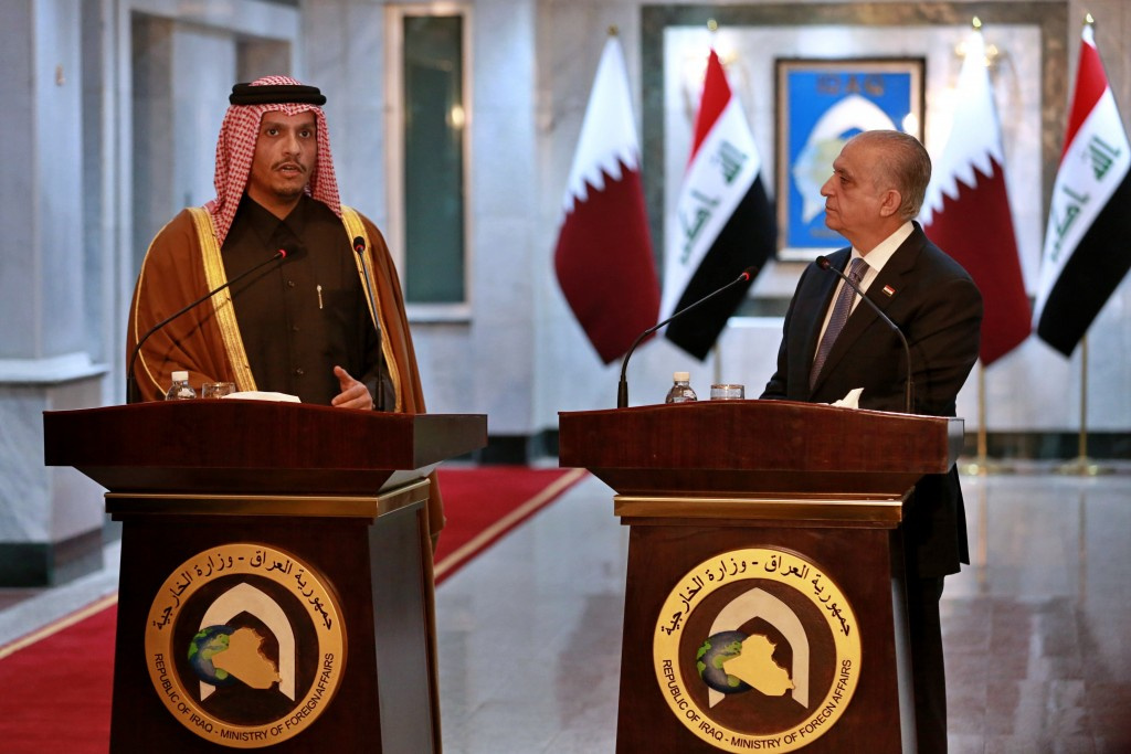Iraqi Foreign Minister Mohamed Alhahkim, right, holds a press conference with visiting Qatari counterpart Sheikh Mohammed bin Abdulrahman Al Thani in ...