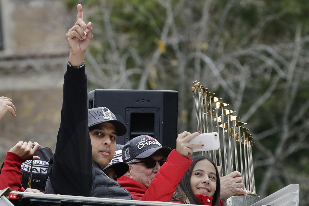 FILE— In this Oct. 31, 2018, file photo, Boston Red Sox manager Alex Cora rides with the trophy during a parade in Boston to celebrate the team's Worl...