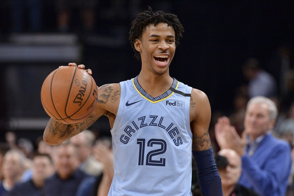 Memphis Grizzlies guard Ja Morant reacts while the Grizzlies run out the clock in an NBA basketball game against the Houston Rockets on Tuesday, Jan. ...