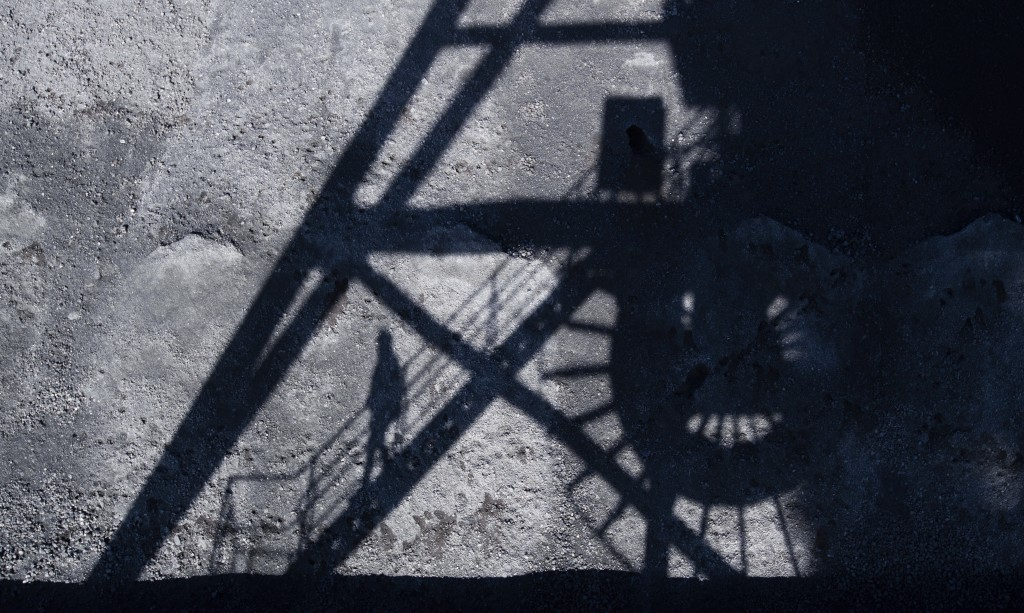 A man casts his shadow in the coal port of the Mehrum coal-fired power plant in the district of Peine in Hohenhameln, Germany, Wednesday, Jan. 15, 202...