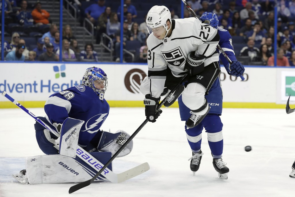 Los Angeles Kings right wing Dustin Brown (23) screens Tampa Bay Lightning goaltender Andrei Vasilevskiy (88) on a goal by left wing Kyle Clifford (no...