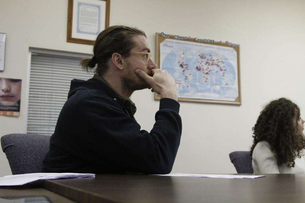 In this Nov. 12, 2019, photo, attorney Nicholas Palazzo watches a presentation by a coworker at Las Americas Immigrant Advocacy Center, in El Paso, Te...