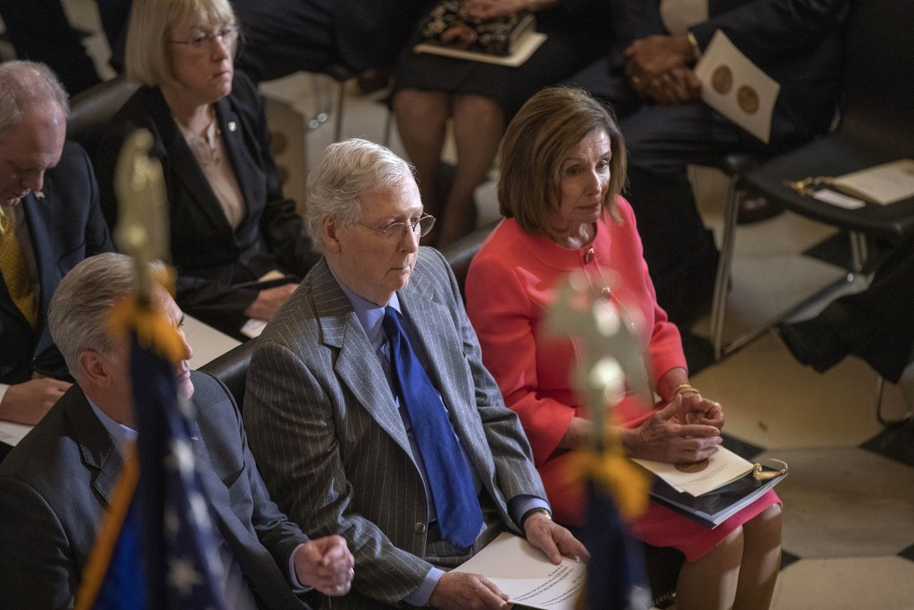 House Speaker Nancy Pelosi and Senate Majority Leader Mitch McConnell of Ky., join Congressional leadership and other members of Congress at a Congres...
