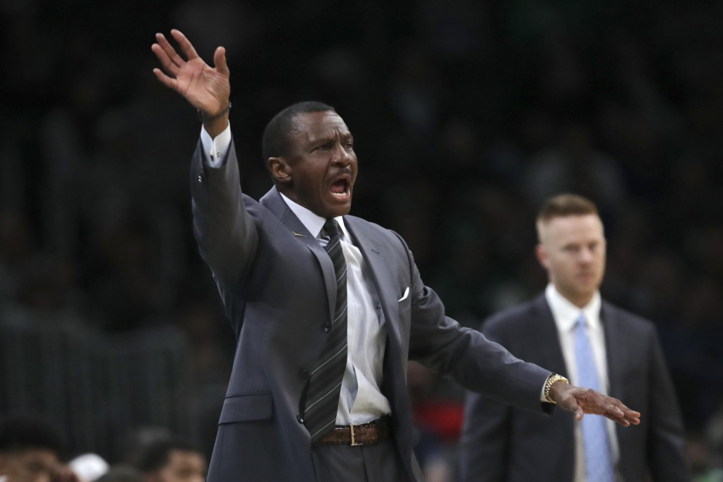 Detroit Pistons head coach Dwane Casey calls to his players during the first half of an NBA basketball game against the Boston Celtics in Boston, Wedn...