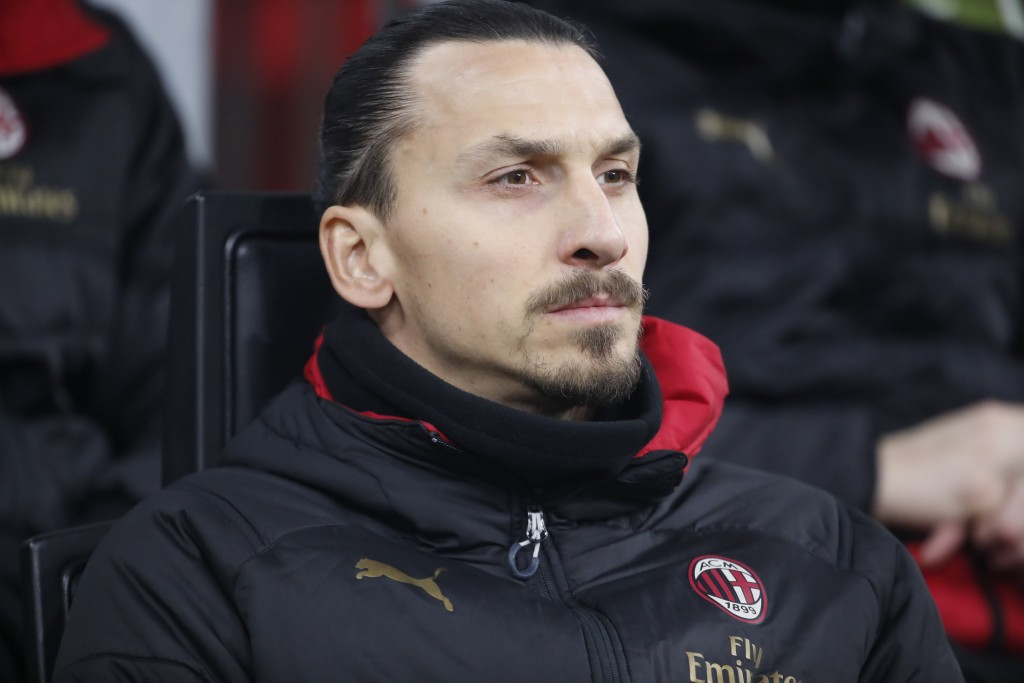 AC Milan's Zlatan Ibrahimovic sits on the bench prior of the Italian Cup soccer match between AC Milan and Spal at the San Siro stadium, in Milan, Ita...