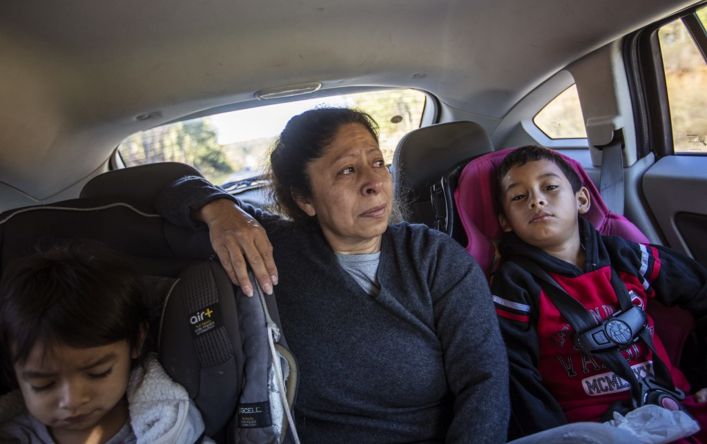 Maria Campos, 52, fights back tears while approaching the Stewart Detention Center with her grandkids to visit her son, Sunday, Nov. 10, 2019, in Lump...