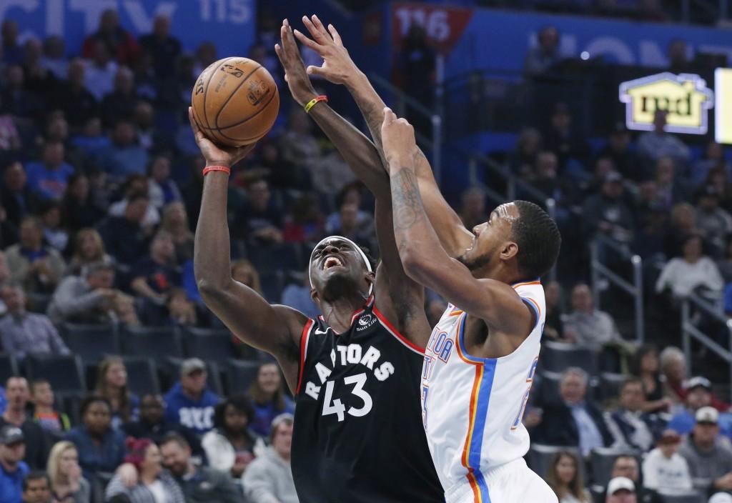 Toronto Raptors forward Pascal Siakam (43) shoots as Oklahoma City Thunder guard Terrance Ferguson defends during the first half of an NBA basketball ...