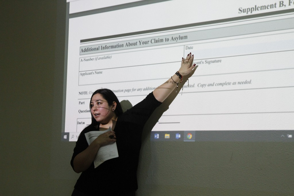 In this Nov. 15, 2019, photo, Crystal Sandoval, of El Paso, Texas-based Las Americas Immigrant Advocacy Center, gives an asylum application workshop i...