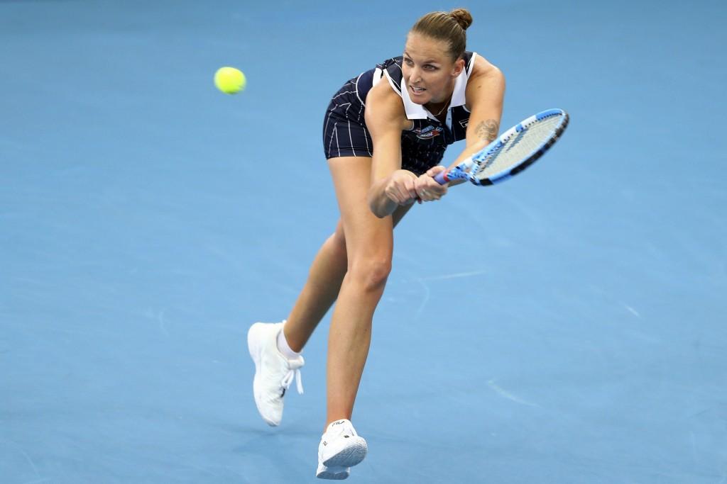 FILE - In this Jan. 9, 2020, file photo, Karolina Pliskova, of the Czech Republic, plays a shot during her match against Ajla Tomljanovic, of Australi...