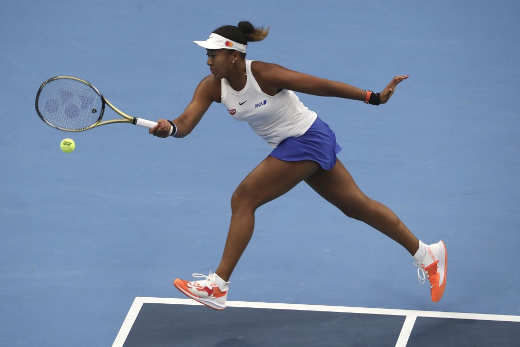 FILE - In this Oct. 6, 2019, file photo, Naomi Osaka, of Japan, hits a return against Ashleigh Barty, of Australia, during their women's final at the ...
