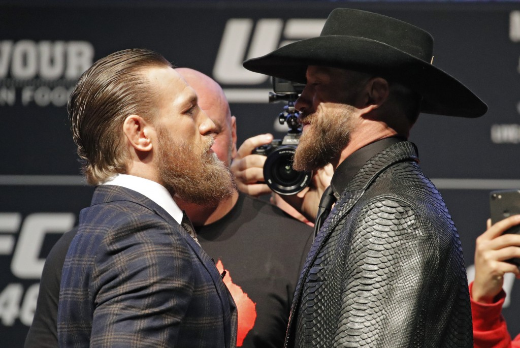 "Conor McGregor, left, and Donald ""Cowboy"" Cerrone pose for photographers during a news conference for a UFC 246 mixed martial arts bout, Wednesday, Ja..."