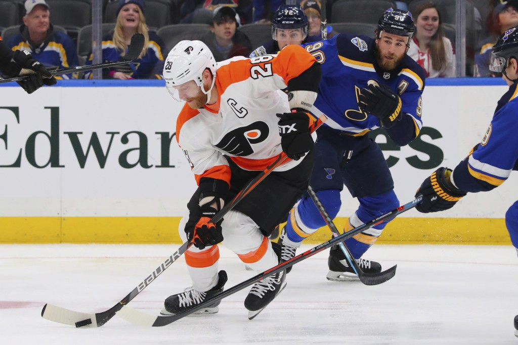 Philadelphia Flyers center Claude Giroux (28) controls the puck against St. Louis Blues center Ryan O'Reilly (90) during the first period of an NHL ho...