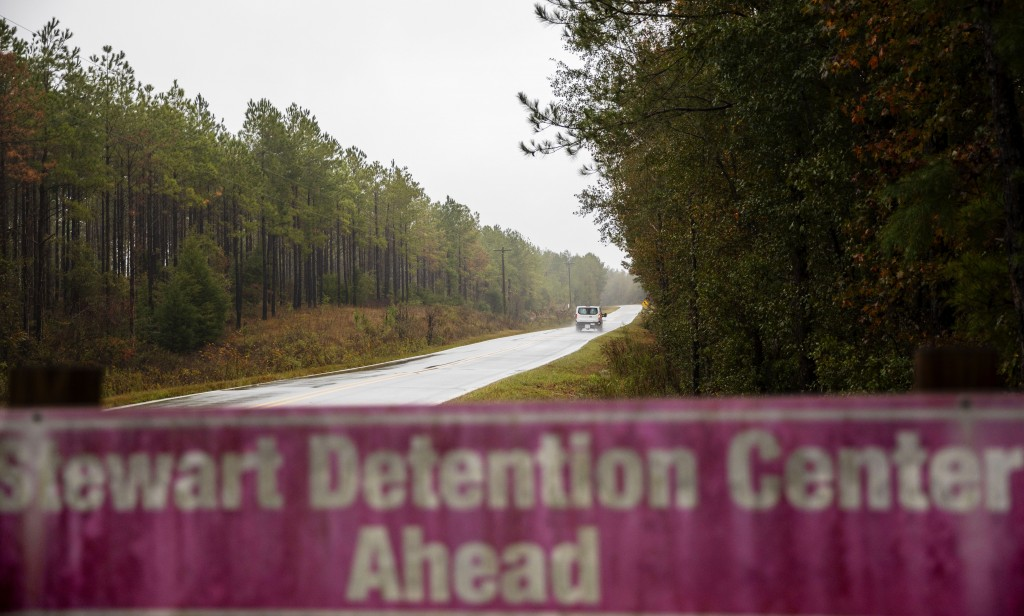 In this Nov. 15, 2019, photo, a detainee transport van travels the rural road back to the Stewart Detention Center in Lumpkin, Ga. The rural town is a...