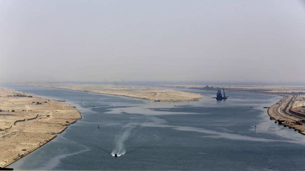 FILE - In this Aug. 6, 2015 file photo, an army zodiac secures the entrance of the new section of the Suez Canal in Ismailia, Egypt. The Suez Canal, w...