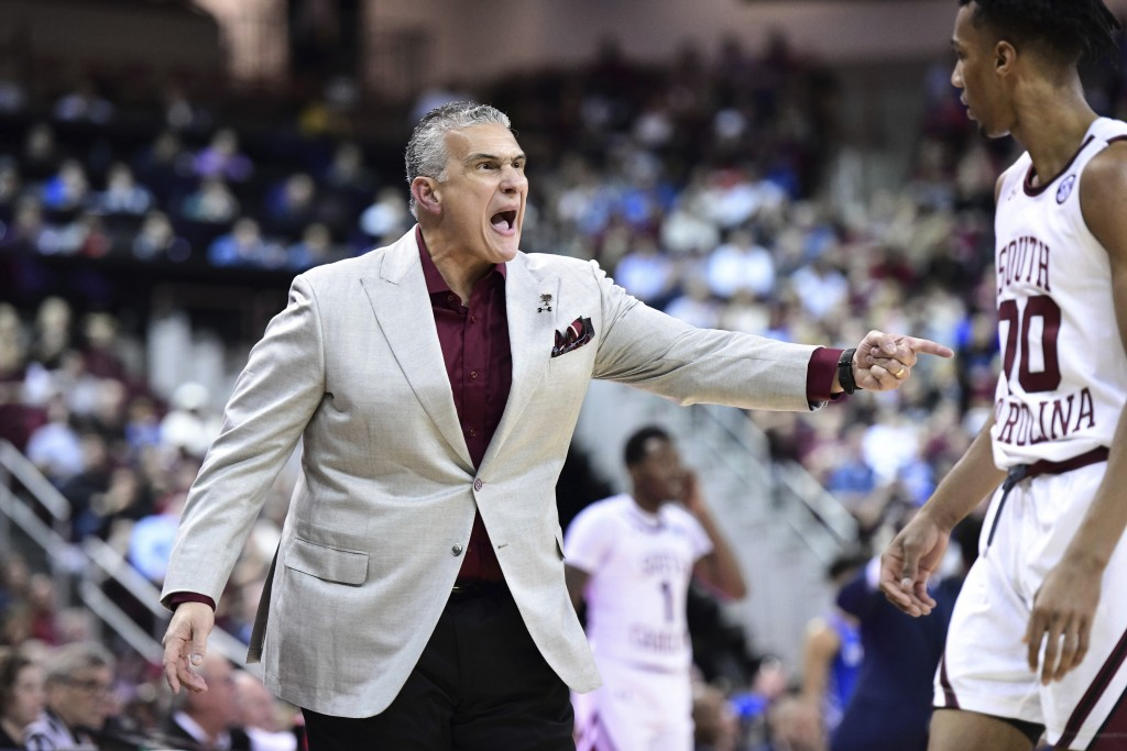 South Carolina coach Frank Martin yells to A.J. Lawson (00) during the first half of the team's NCAA college basketball game against Kentucky on Wedne...