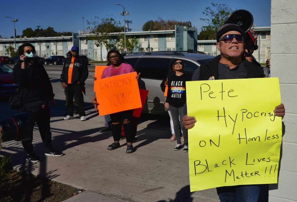 Protestors with Black Lives Matter protest a visit by Democratic presidential candidate and former South Bend, Ind., Mayor Pete Buttigieg, during a vi...