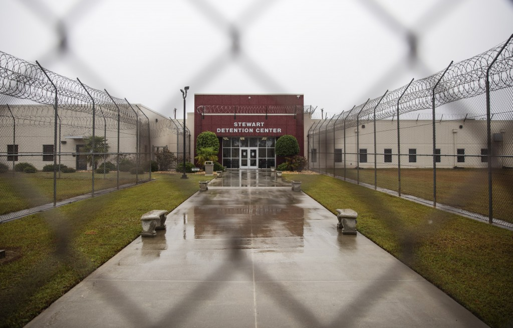 The Stewart Detention Center is seen through the front gate, Friday, Nov. 15, 2019, in Lumpkin, Ga. The rural town is about 140 miles southwest of Atl...