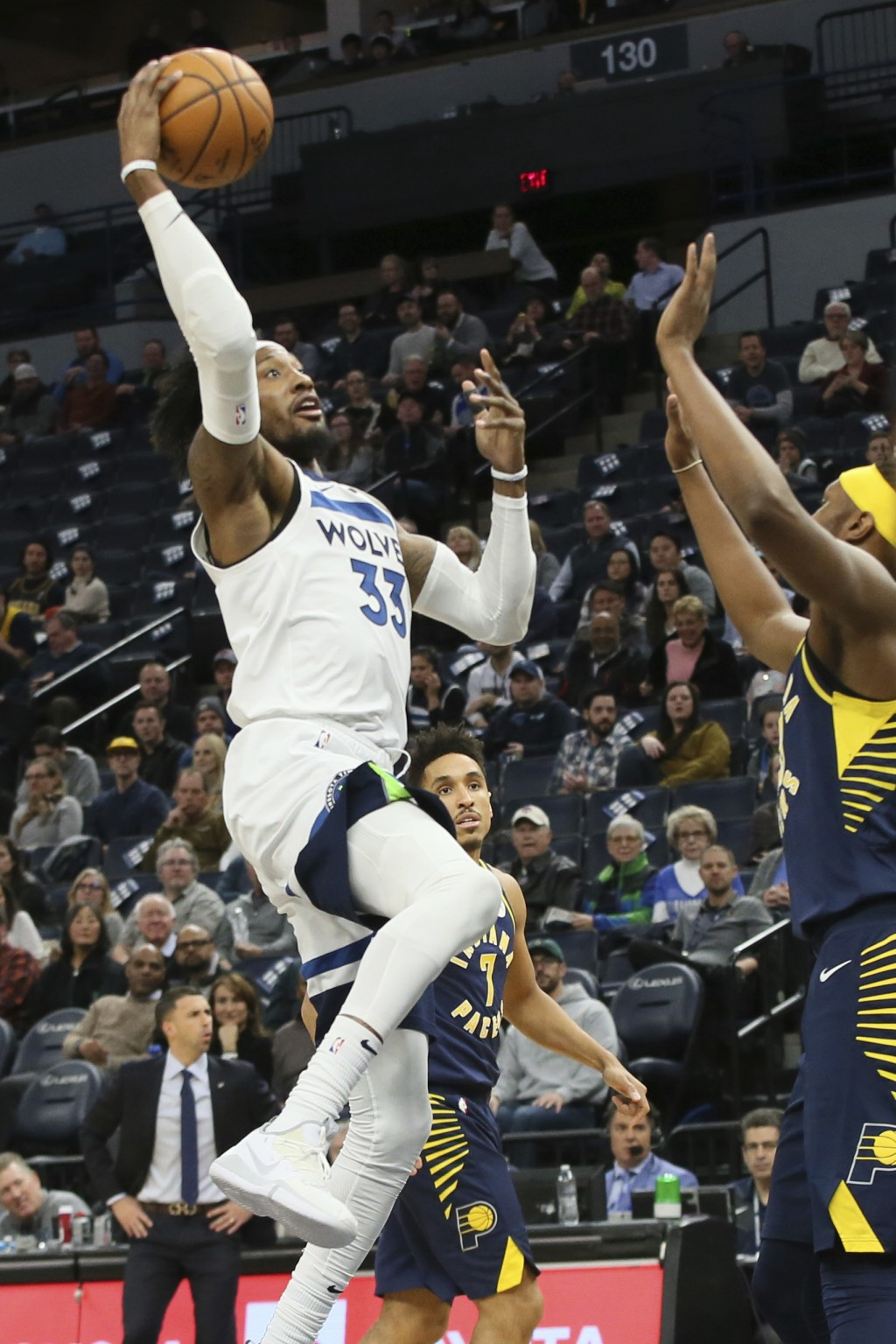 Minnesota Timberwolves' Robert Covington, left, shoots as Indiana Pacers' Myles Turner defends in the first half of an NBA basketball game Wednesday, ...