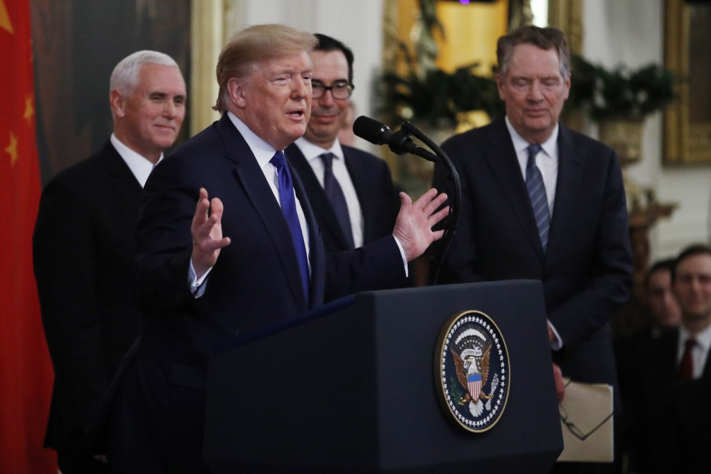 President Donald Trump, gestures, as Vice President Mike Pence, back left, Secretary of Treasury, Steven Mnuchin, back center, and U.S. Trade Represen...