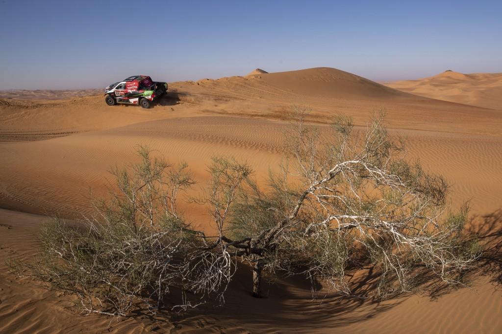 Driver Yazeed Al Qassimi, of Saudi Arabia, and co-driver Konstantin Zhiltsov, of Russia, race their Toyota during stage eleven of the Dakar Rally betw...