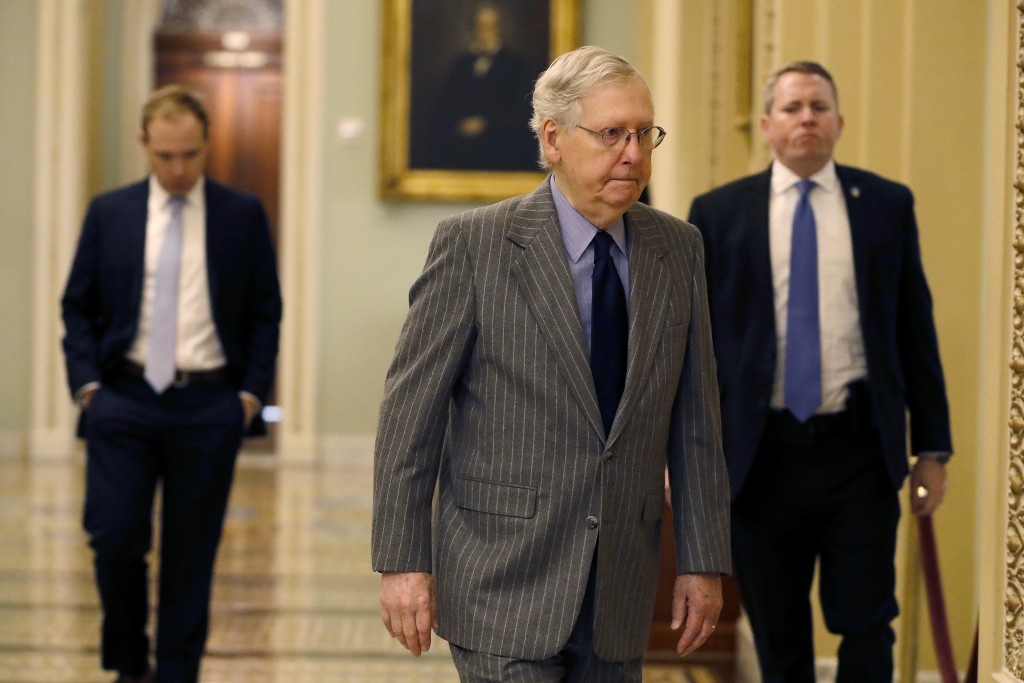 Senate Majority Leader Mitch McConnell, R-Ky., arrives at the Capitol, in Washington, Wednesday, Jan. 15, 2020. Speaker of the House Nancy Pelosi, D-C...