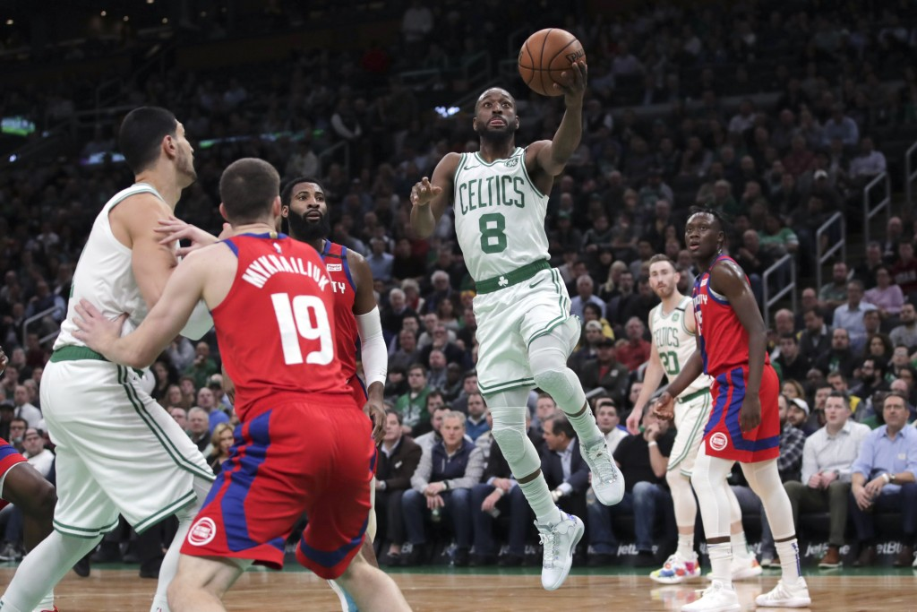 Boston Celtics guard Kemba Walker (8) drives to the basket against the Detroit Pistons during the first half of an NBA basketball game in Boston, Wedn...