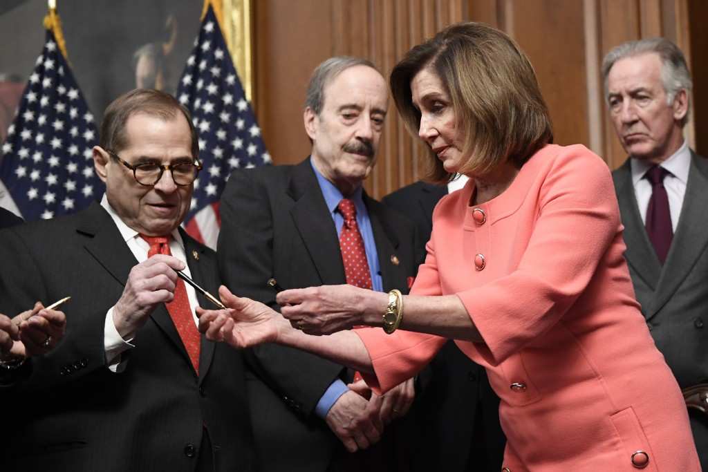 House Speaker Nancy Pelosi of Calif., second from right, gives pens to, from left, House Judiciary Committee Chairman Rep. Jerrold Nadler, D-N.Y., Hou...